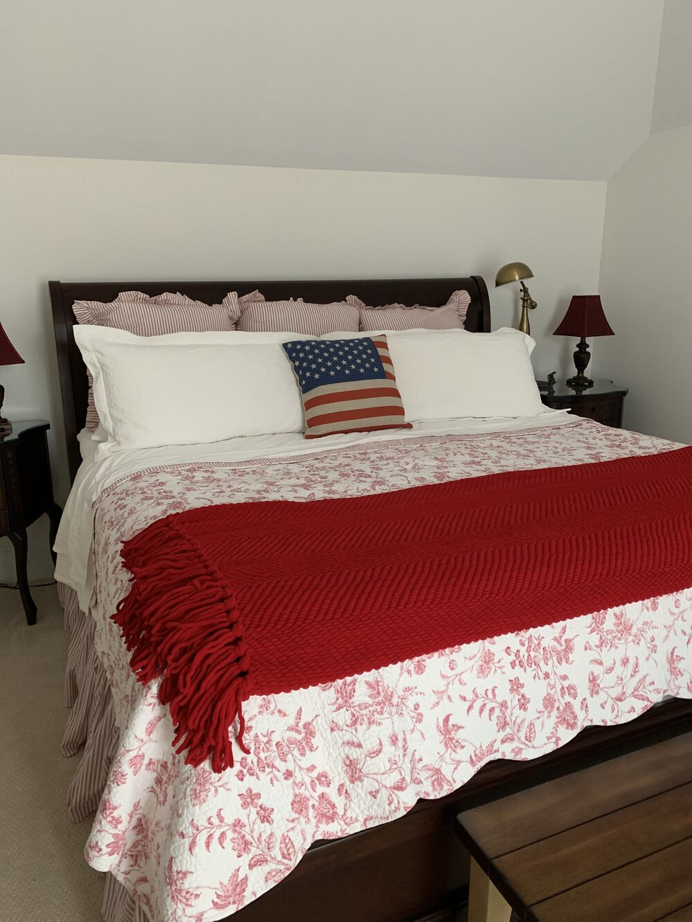 Here's a cute flag pillow on my red and white guest bedroom bed.