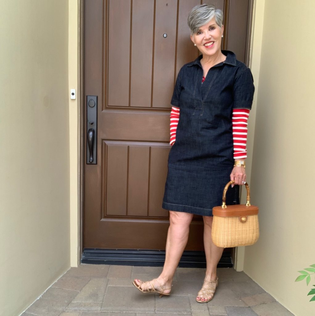A blue denim jean dress worn over a red and white striped tee.  Cute red, white and blue look to take you most anywhere.