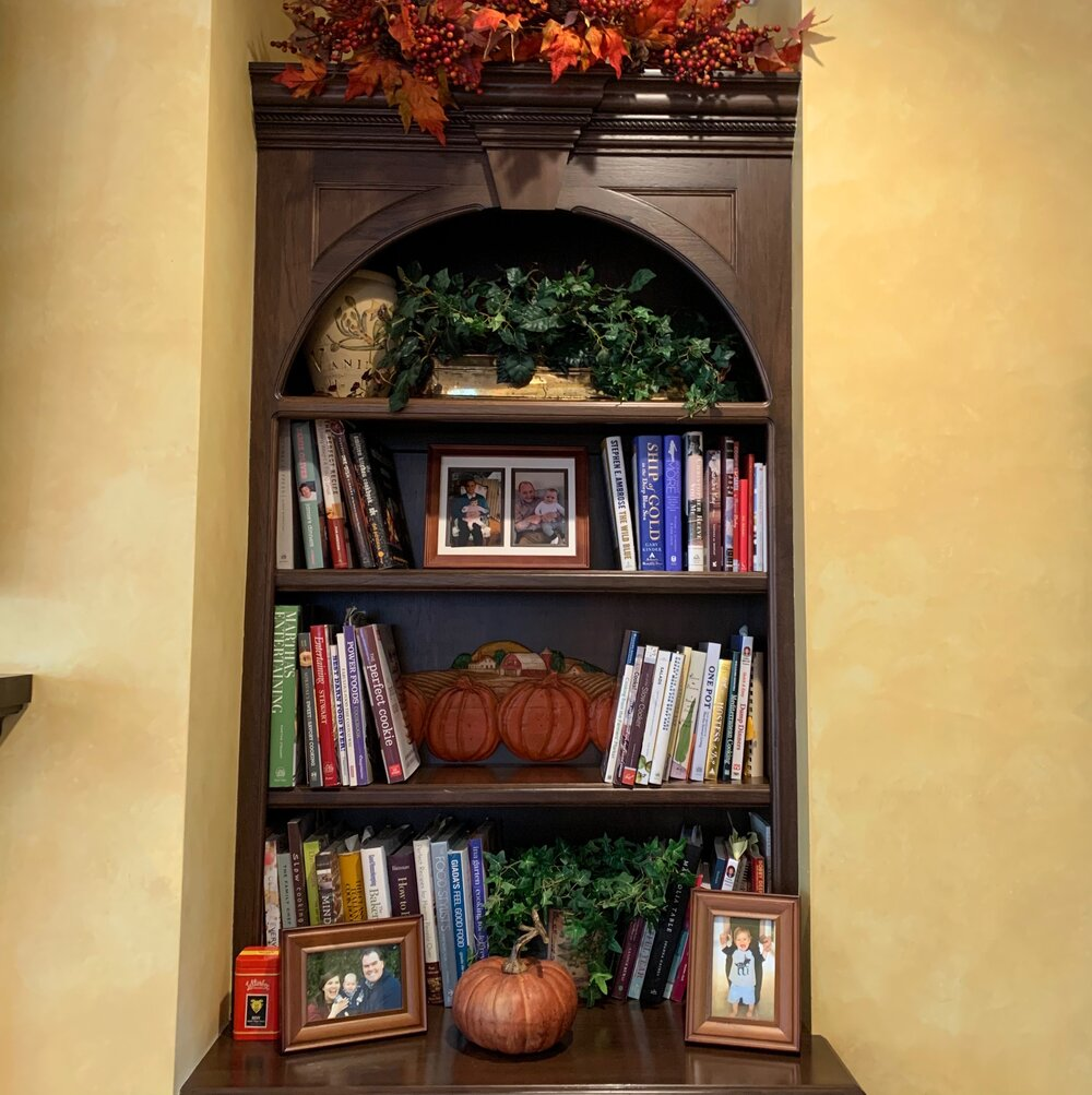 My fall home decor ideas for the great room with pumpkins and fall leaf garlands.