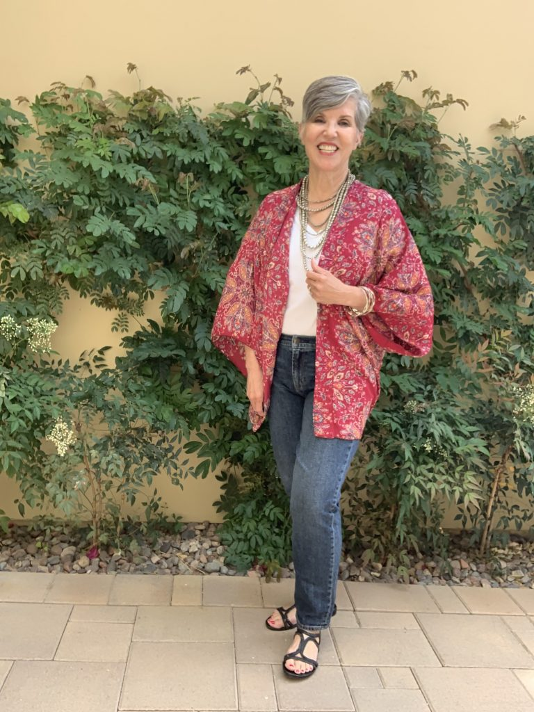 Jeans and tee worn with a silver multi-stranded necklace, silver bangles and a great print ruana or kimono.
