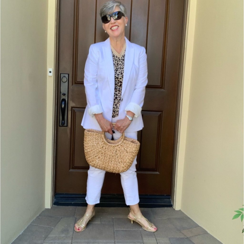 Here I am wearing an animal print tee with the white blazer, white jeans and cute straw bag.