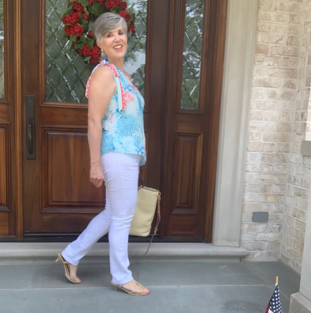 One shoulder top with white jeans