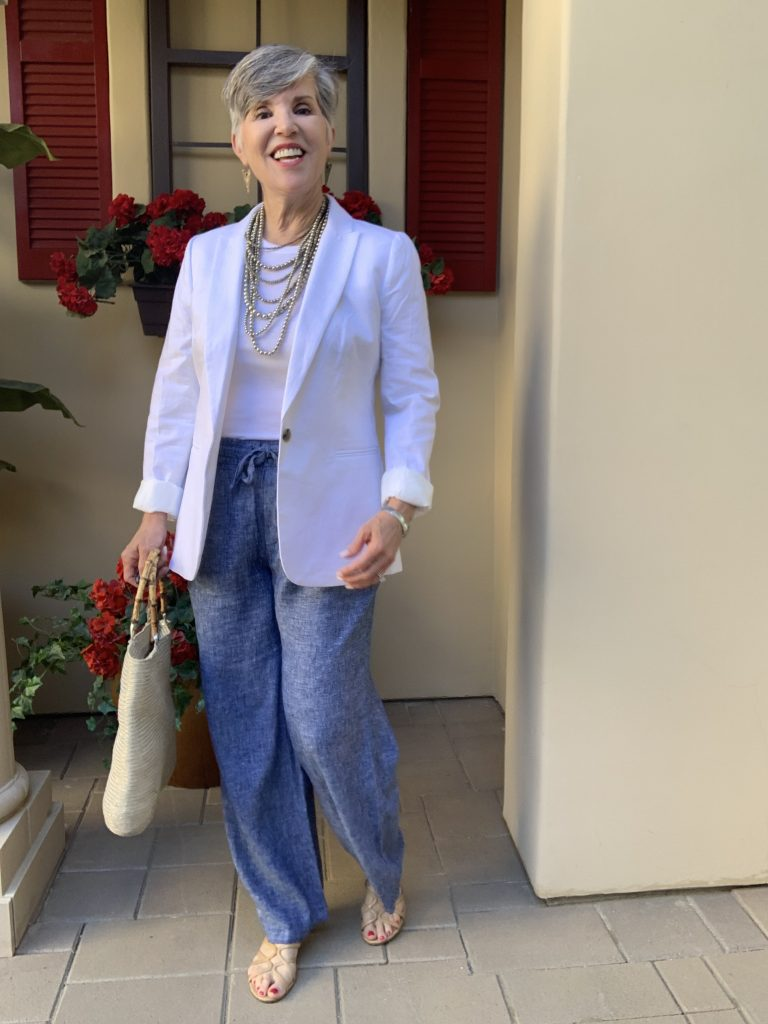 I'm wearing a white linen blazer with blue palazzo pants, a racer back tee and a silver mulit-stranded necklace.