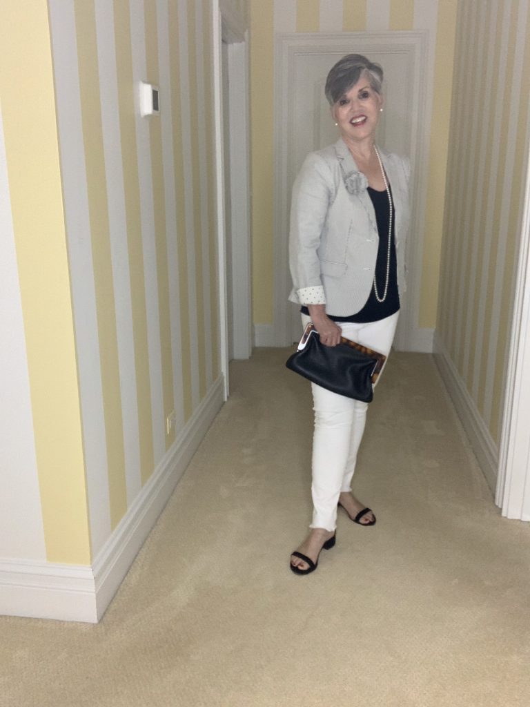 seersucker jacket with black and white items and pearls