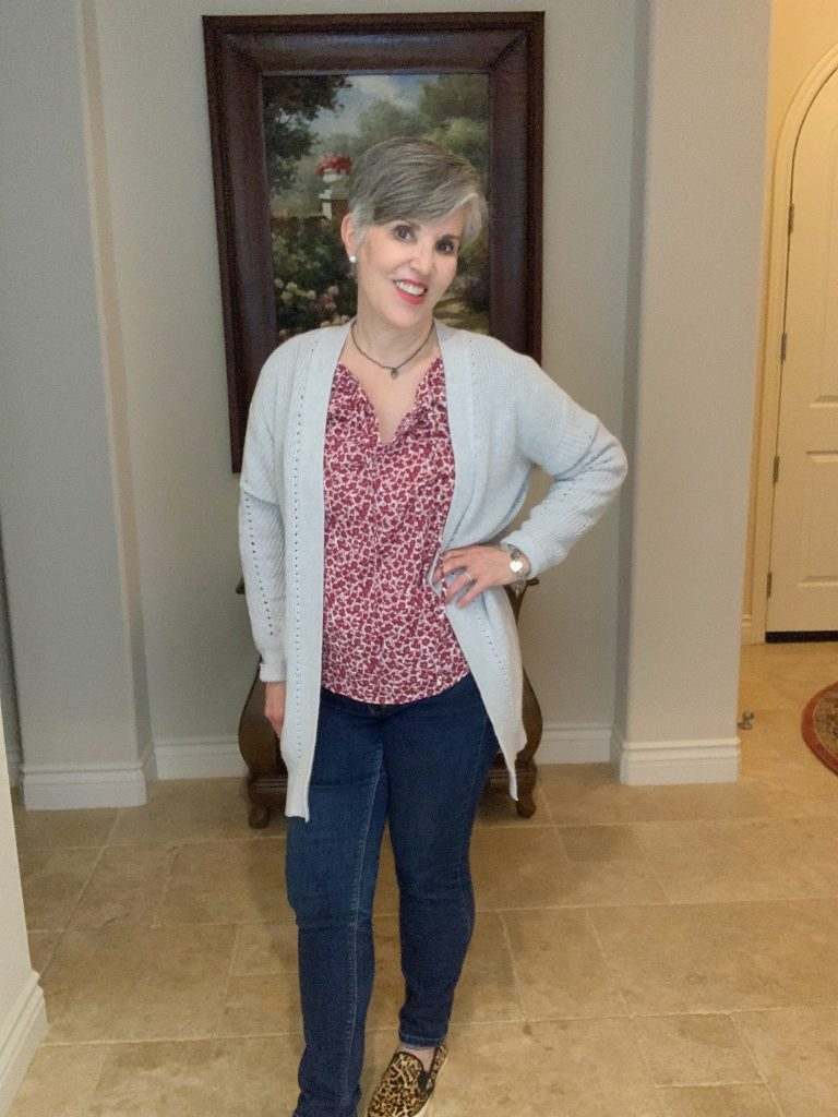 burgundy boho top with gray oversized cardigan over skinny jeans with leopard slip-ons