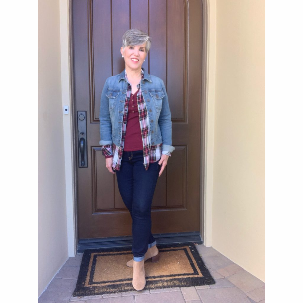burgundy henley with plaid over-shirt and light wash jean jacket, dark wash skinnny jeans and booties